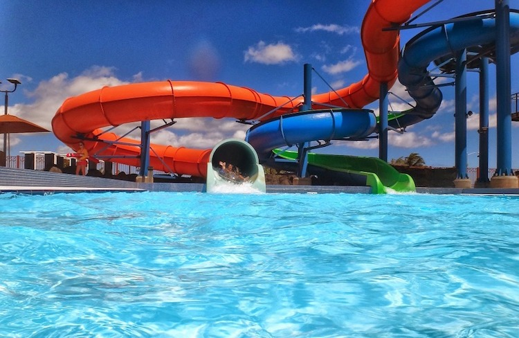 child at the water park