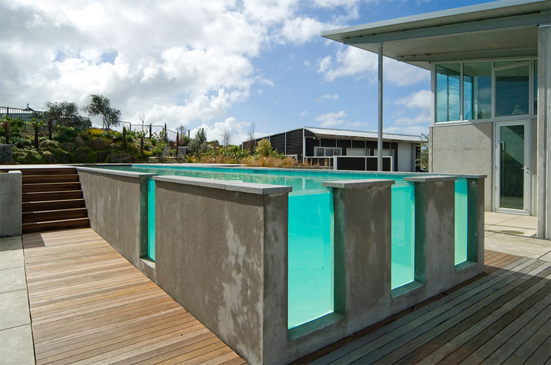 Glass And Stone Are Used To Great Effect Here The Wood Decking Is Actually At Ground Level Pool In Fact Being As A Centre Point Of Interest