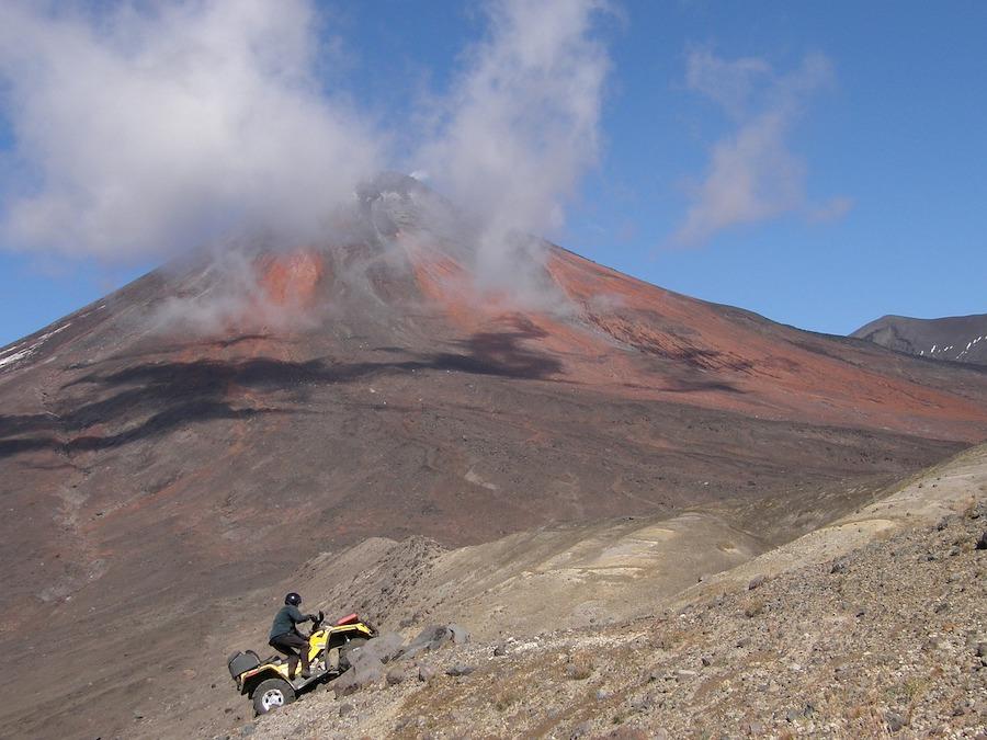 atv rider and volcano