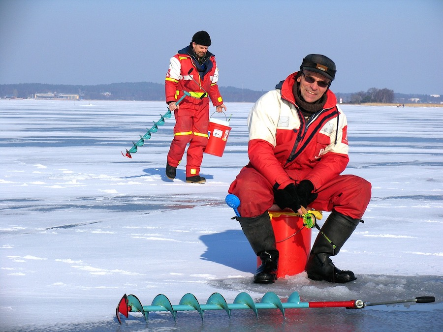 two men ice fishing