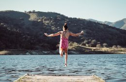 girl jumping off dock